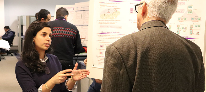 PhD Student Parisa Hassanzadeh presents her poster to an Industrial Affiliate member.