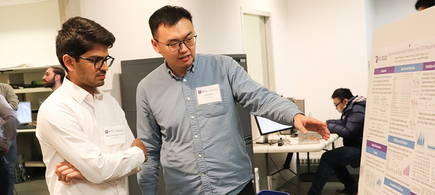 Students Suyash Sule & Lifan Mei discuss their research at the NYU WIRELESS Open House event.